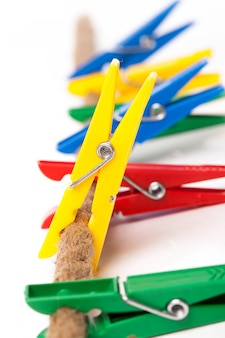 Closeup image of colorful clothespins on a cord