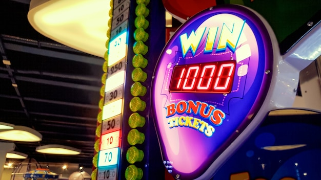 Closeup image of neon display showing jackpot in casino or lottery at amusement park