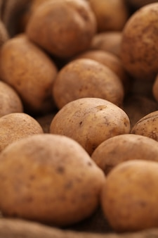 Closeup image of a rustic unpeeled potatoes