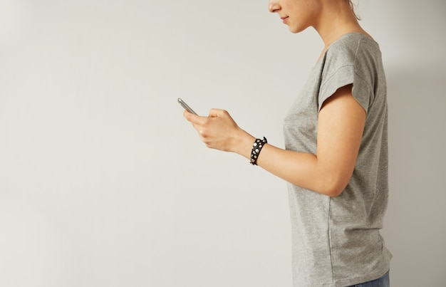 Closeup image of a teenager is searching information in network on mobile phone