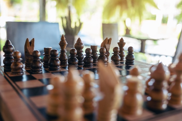 Closeup image of a wooden chess set on chessboard