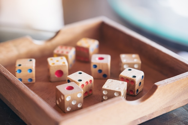 Closeup image of wooden dices in a box