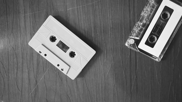 Closeup images of cassette tape on retro wood table represent nostalgia mood or moment to 80s
