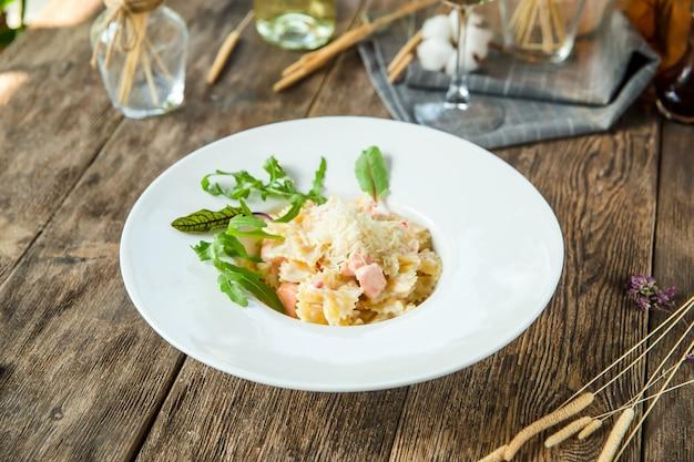 Closeup on italian salmon pasta farfalle