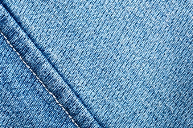 A closeup of jeans fabric with seam