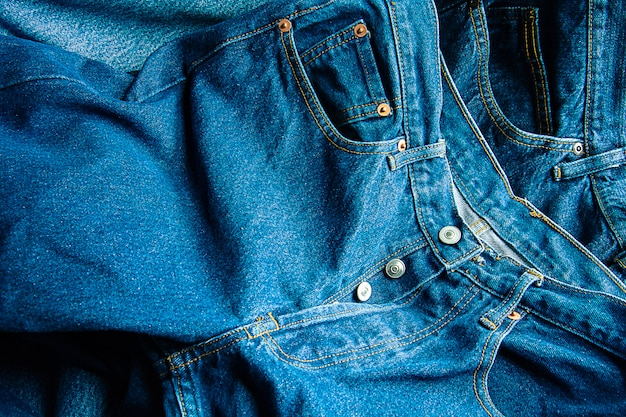 Closeup of jeans texture background, lot of different blue jeans