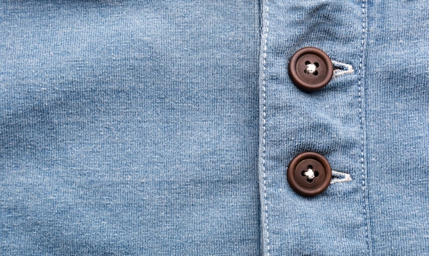 Closeup of jeans with buttons in a row