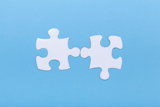 Closeup of jigsaw puzzle on blue missing jigsaw puzzle piece