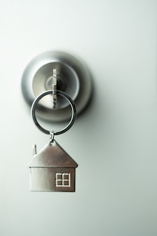 Closeup key on the door, personal loan concept. soft focus.