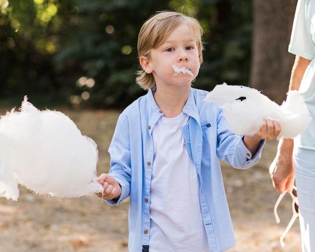 Closeup kid holding cotton candy
