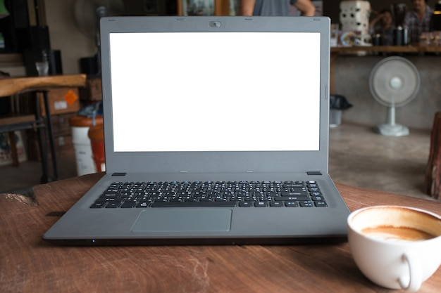Closeup of labtop computer with blank display in coffee shop concept imege made advertize product