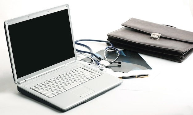 Closeup. laptop and stethoscope in the workplace therapist .the concept of health