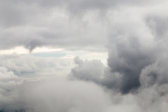 Closeup large gray clouds.
