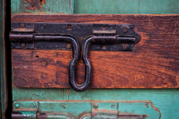 Closeup of latch door look on wooden door