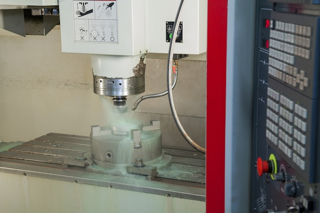 Closeup lathe machine and coolant during processing