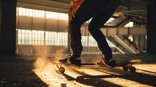 Closeup of legs and sneakers on skateboard