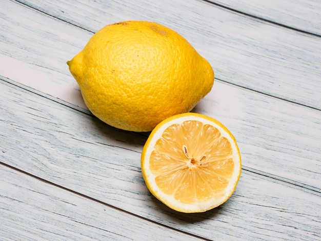 Closeup of a lemon on a wooden table
