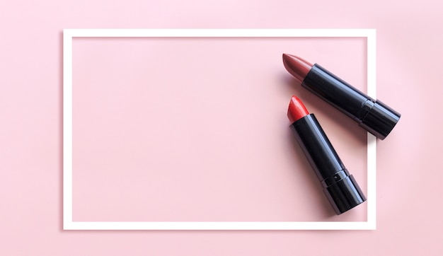 Closeup lipstick on pink background. over light and sooft-focus