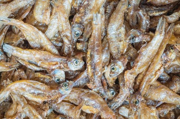 Closeup little fried fish texture background