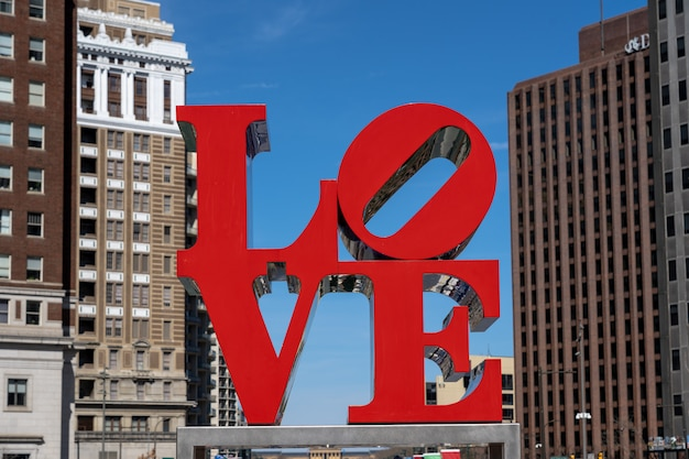Closeup love park charactor over the modern building in philadelphia. usa