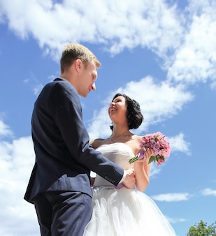 Closeup. loving couple on the wedding day. on the background of the sky
