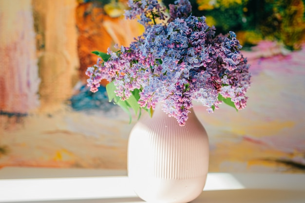 Closeup macro detailed photo of blooming beautiful lilac branches bouquet on abstract wall.  vase with spring summer flowers.