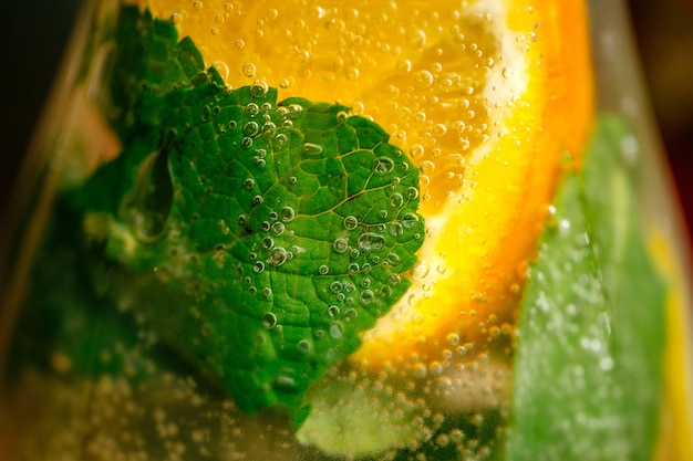 Closeup macro on fresh lemonade with mint and orange