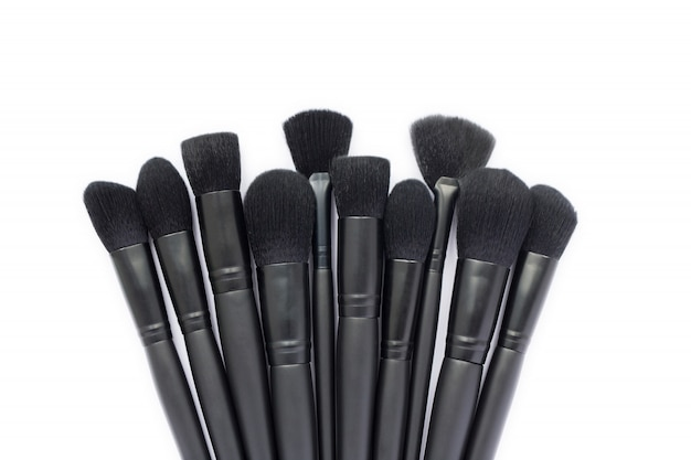 Closeup of makeup brushes collection isolated on white space