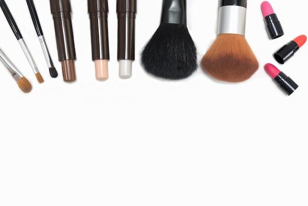 Closeup makeup cosmetics lipstick and brushes