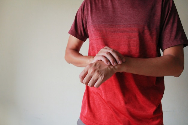 Closeup of male arms holding his painful wrist