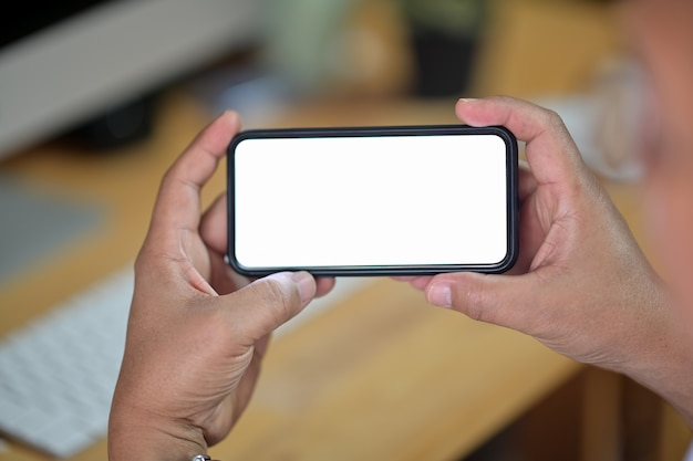 Closeup of male hands holding blank screen mobile smart phone