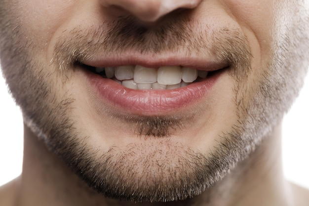 Closeup of male mouth. healthy smile.
