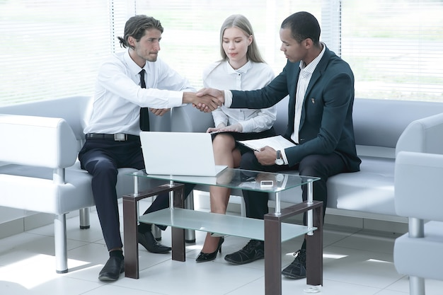 Closeup .the manager confirms the transaction with the client.business handshake