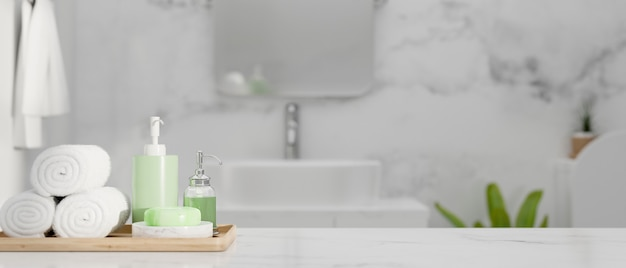 Closeup of marble countertop with space and set of bathing over stylish marble bathroom