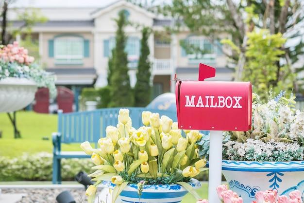 Closeup metal mailbox on garden view textured background