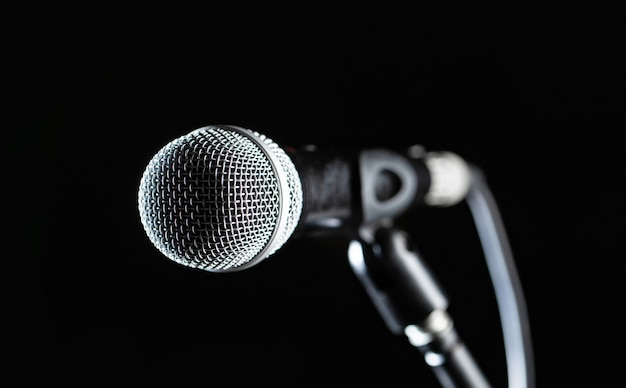Closeup microphone. vocal audio mic on a bleck background. live music, audio equipment. karaoke concert, sing sound.