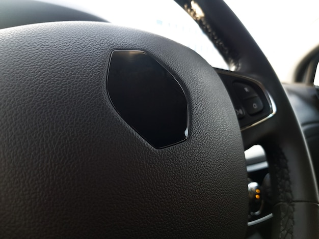 Closeup of a modern leathercovered steering wheel