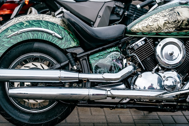Closeup of motorbike with lots of chrome details. modern powerful perfomance road motorcycle shiny reflexive surface engine with exhaust pipes.  driving industry.  two-wheeled vehicle technologies