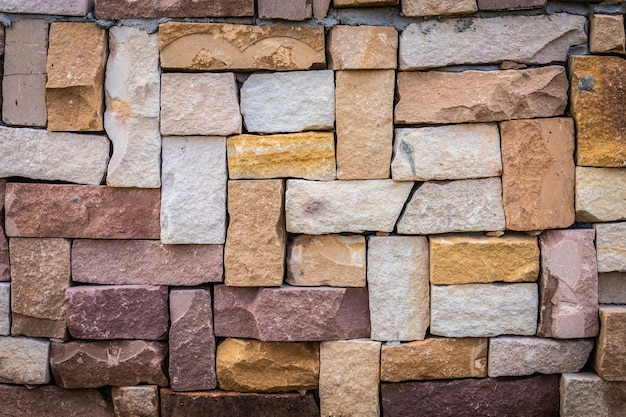 Closeup of multicolored old brick wall background.