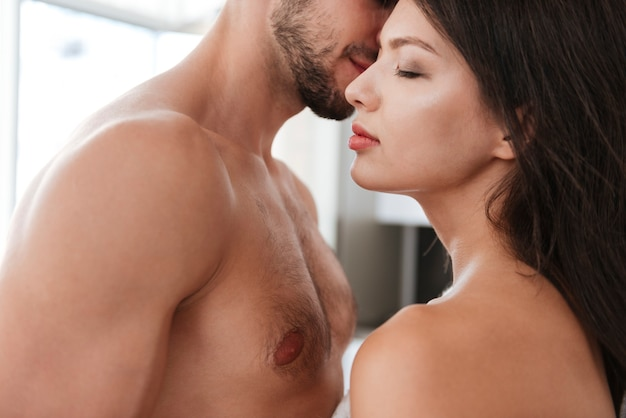 Closeup of naked sensual young couple in love at home