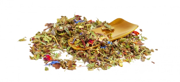 Closeup of natural herbal tea made of various loose dried herbs isolated