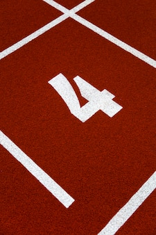 Closeup of the number four on running track