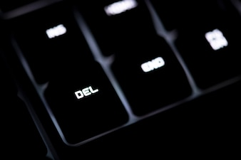 Closeup of a black computer keyboard and DEL button