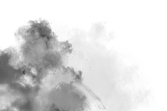 Closeup of black dust particles explode isolated on white background.