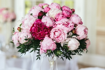 Closeup of bouquet made of white and pink peonies