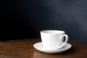 Closeup of coffee cup on wooden table