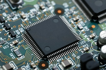 Closeup of electronic circuit board with CPU microchip electronic components background