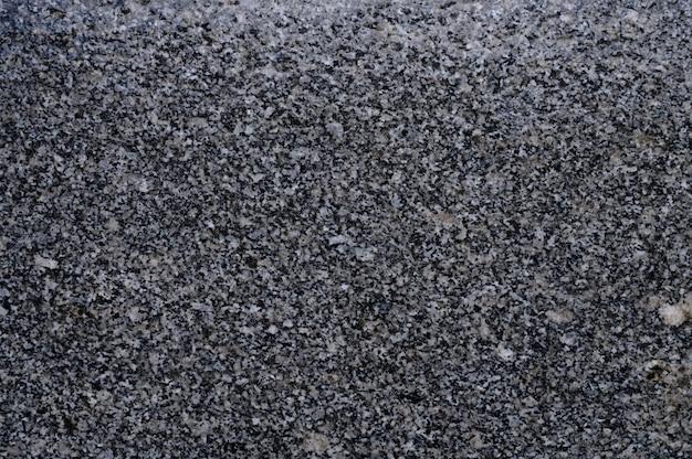 背景の灰色のタイル張りの通路のテクスチャのクローズアップ
