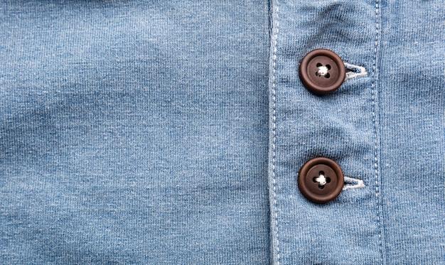 連続したボタンとジーンズのクローズアップ