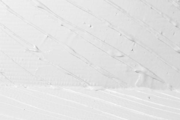 석고 흰색 모서리, 일치와 거친 치장 용 벽 토 텍스처의 근접 촬영. 구호 줄무늬가있는 배경, 여유 공간. 수제 패턴, 장식 디자인, diy 컨셉